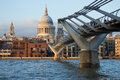 Iconic view london famous pedestrian millennium bridge over thames views st paul s cathedral warm rays setting sun Stock Photography