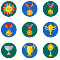 Icons cups, awards, medals in the flat style. Vector image on a round colored background. Element of design, interface