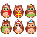 Icons in the form of colorful owls in winter hats on a white background Royalty Free Stock Image