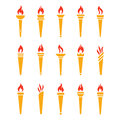Icons golden torch with flame isolated vector set