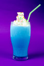 Icy blue milk shake purple background Stock Photo