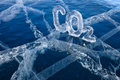 Icy chemical formula of carbon dioxide co greenhouse gas made from ice on winter frozen lake baikal Royalty Free Stock Photo