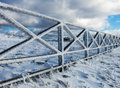 Icy fence in snowy carpathians winter Royalty Free Stock Images