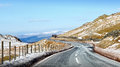 Icy mountain road heading down to lake in the welsh landscape of tal y llyn wales Royalty Free Stock Photography