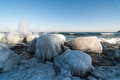 Icy Rocks by a Lake in Winter Stock Photos