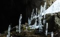 Icy stalagmites at Karani-koba cave in Crimea mountains, Ukraine Stock Photo
