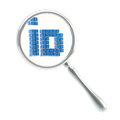 ID under the magnifier isolated Royalty Free Stock Photography
