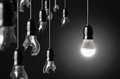 Idea concept with broken bulbs and one led glowing bulb Royalty Free Stock Image