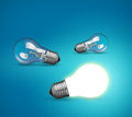 Idea concept with glowing light bulb on blue background Stock Photo