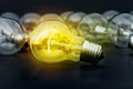 Idea concept with incandescent light bulbs Stock Photo