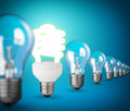 Idea concept with light bulbs on blue Stock Photography