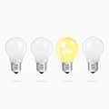 Idea concept with light bulbs three switched off upside down and one bulb alight text Stock Images
