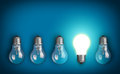 Idea concept with row of light bulbs and glowing bulb Royalty Free Stock Photos