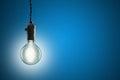 Idea concept - Vintage incandescent bulb on blue background
