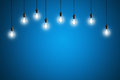 Idea concept - Vintage incandescent bulbs on blue background Royalty Free Stock Photo
