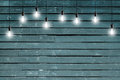 Idea concept - Vintage incandescent bulbs on blue wooden wall Royalty Free Stock Photo