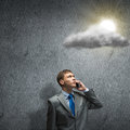 Idea concept young upset businessman standing in rays of light Royalty Free Stock Image