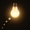 Idea lit incandescent lamp shaped in a think balloon Stock Photography