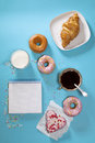 Ideal breakfast for the proper energy for the full day. Fresh coffee with milks and donuts . Hipster pictures. Top view Royalty Free Stock Photo
