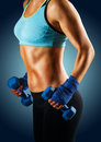 Ideal sportive torso of young woman isolated with bronzed skin and strong abs muscles Royalty Free Stock Photo