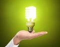 Ideas bulb light on hand a Stock Photo