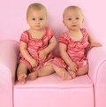 Identical twin girls Stock Photo