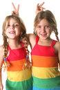 Identical twin sisters showing Royalty Free Stock Image