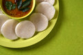 Idli with Sambar in bowl on green background, Indian Dish Royalty Free Stock Photo