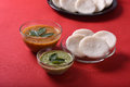 Idli with Sambar in bowl on red background, Indian Dish Royalty Free Stock Photo