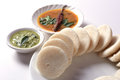 Idli with Sambar in bowl on white background, Indian Dish Royalty Free Stock Photo