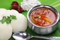 Idli sambar coconut and lime chutney south indian breakfast on banana leaf Stock Photo