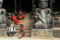 Idols amd people on the steps of temple in bhaktapur nepal Stock Photography