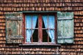 Idyllic bavarian alpine cottage window with curtains and wooden panels Royalty Free Stock Image