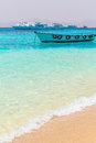 Idyllic beach of mahmya island with empty boat egypt Royalty Free Stock Image