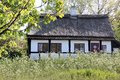 Idyllic country cottage with spring meadow on bornholm denmark Stock Photos