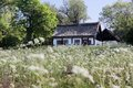 Idyllic country cottage with spring meadow on bornholm denmark Royalty Free Stock Photography