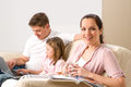 Idyllic family portrait in their home spending leisure time together Royalty Free Stock Photography