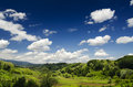 Idyllic landscape with blue sky and green fields Royalty Free Stock Photo
