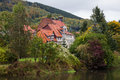 Idyllic landscape with an old house in hannoversch mã nden in germany Stock Image