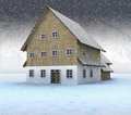 Idyllic mountain cottage at night snowfall Stock Photo