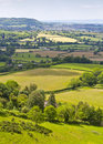 Idyllic rural landscape cotswolds uk view of gently rolling patchwork farmland and villages with pretty wooded boundaries in the Royalty Free Stock Image