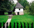 Idyllic summer house small cottage by a green meadow Stock Photo