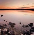 Idyllic sunset over sea water Stock Photography