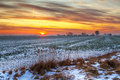 Idyllic sunset over snowy meadow Royalty Free Stock Photo
