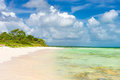 Idyllic tropical beach on cayo coco cuba the touristic landmark of in a sunny day with puffy white clouds Stock Image