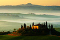 Idyllic view of hilly farmland in Tuscany in beautiful morning light, Italy. Foggy landscape in Tuscany. Belvedere in the Tuscany. Royalty Free Stock Photo