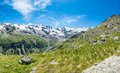 Idyllic view of a mountain valley with snow covered ridge cogne italy Royalty Free Stock Images