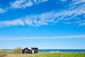 Idyllic wooden cottage near the shore of the baltic sea island ã–land sweden Stock Image