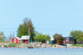 Idyllic wooden cottage near the shore of the baltic sea island ã–land sweden red falurã d falunred harbor fishing harbor wire Royalty Free Stock Photo