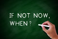 If not now when handwritten chalk concept on the blackboard Royalty Free Stock Photos